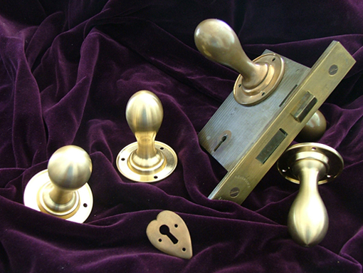 Photo of reproduction bronze door knobs designed by CFA Voysey